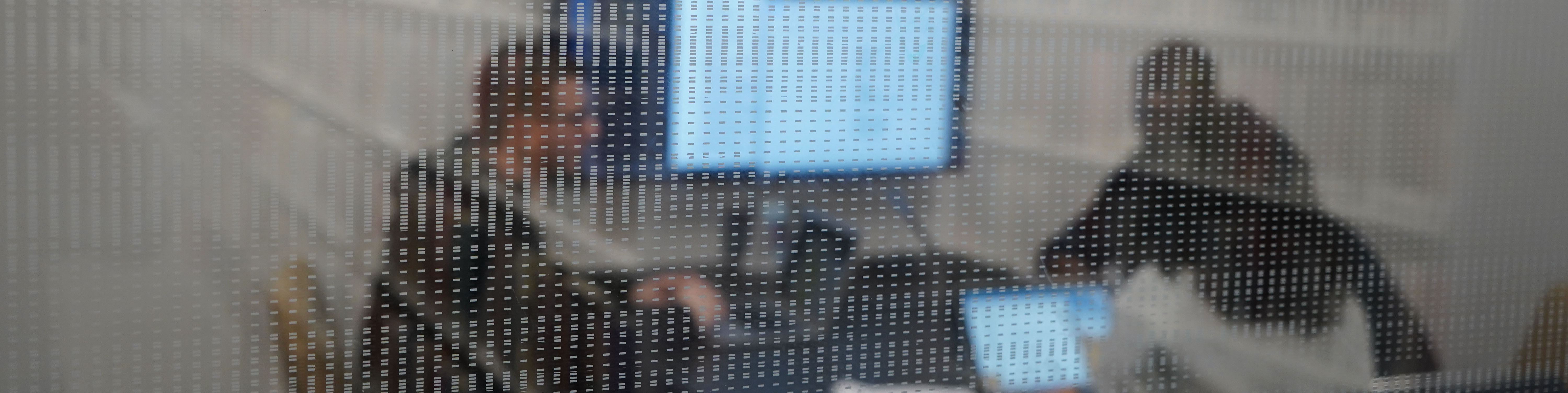 Looking through the glass of a group working together